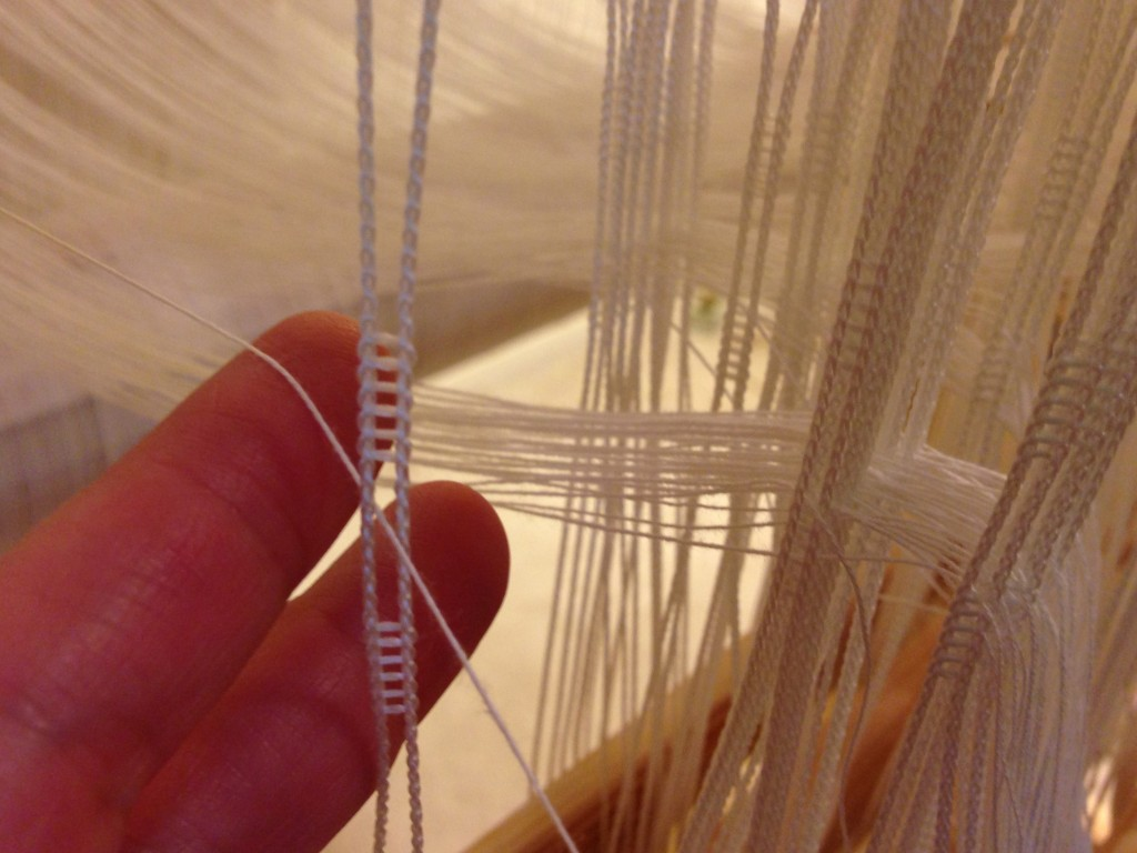 Texsolv heddles being threaded