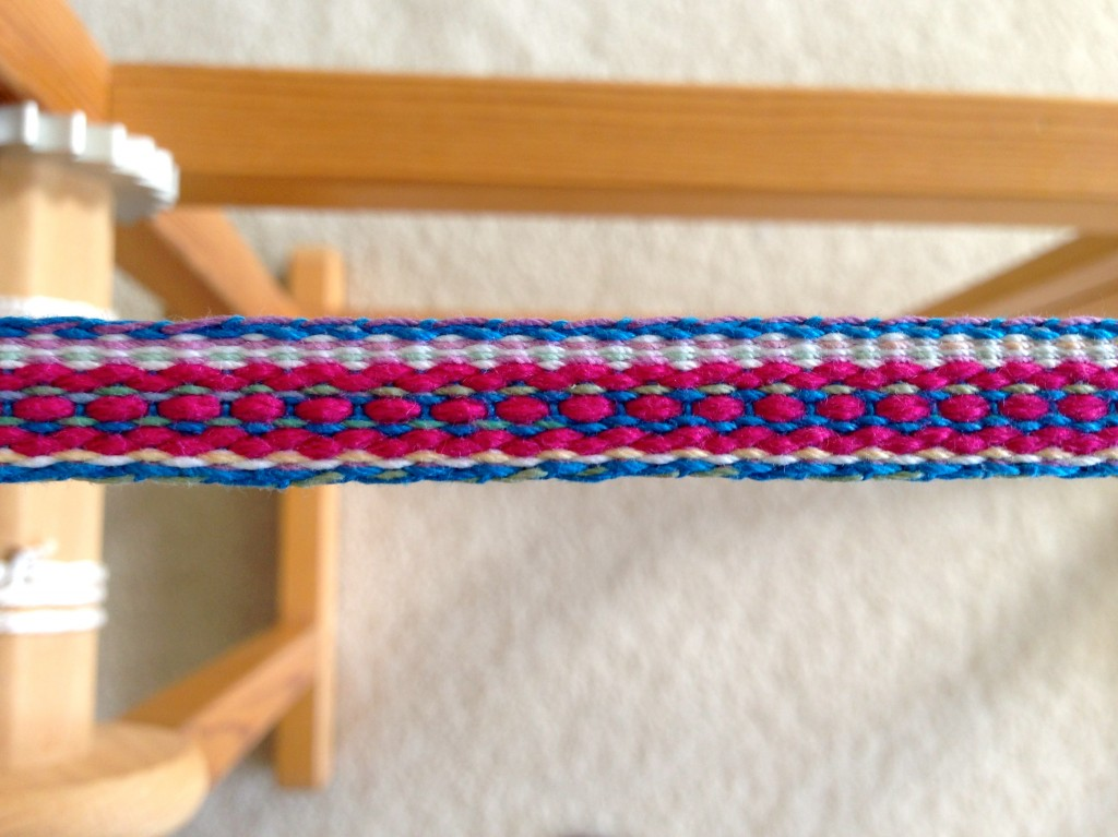 Colorful band woven on two-treadle band loom.
