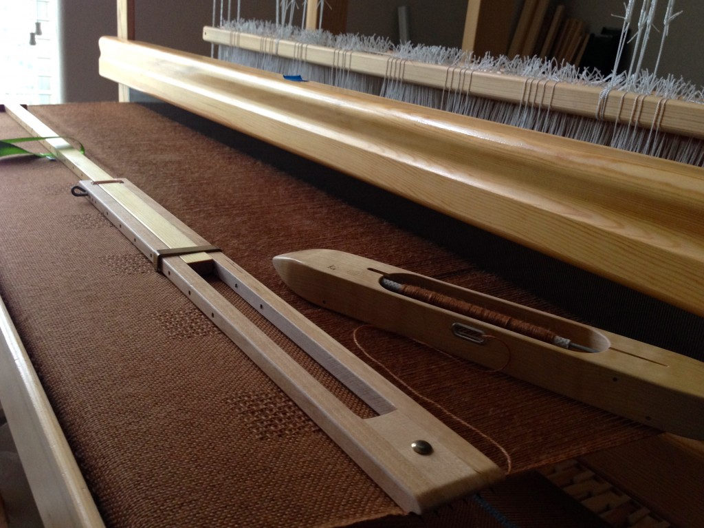 Alpaca/Tencel throw on the loom. Plain weave, with lace weave squares.