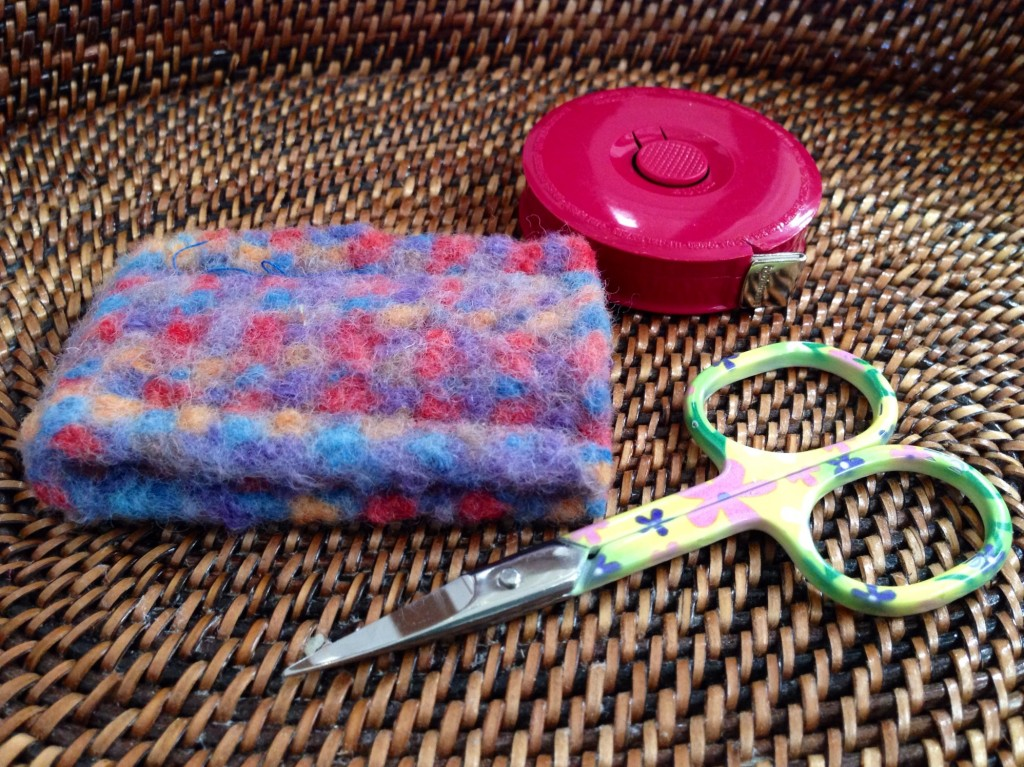 Small pretty scissors and inkle-woven felt sheath.