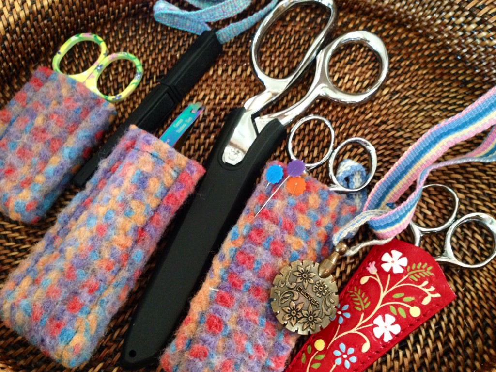 Collection of scissors and their sheaths.