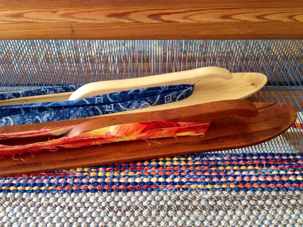 Weaving rag rugs with handmade cherry ski shuttle.