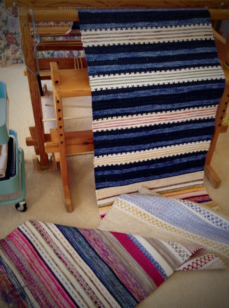 Rosepath rag rugs unfurled from the loom.