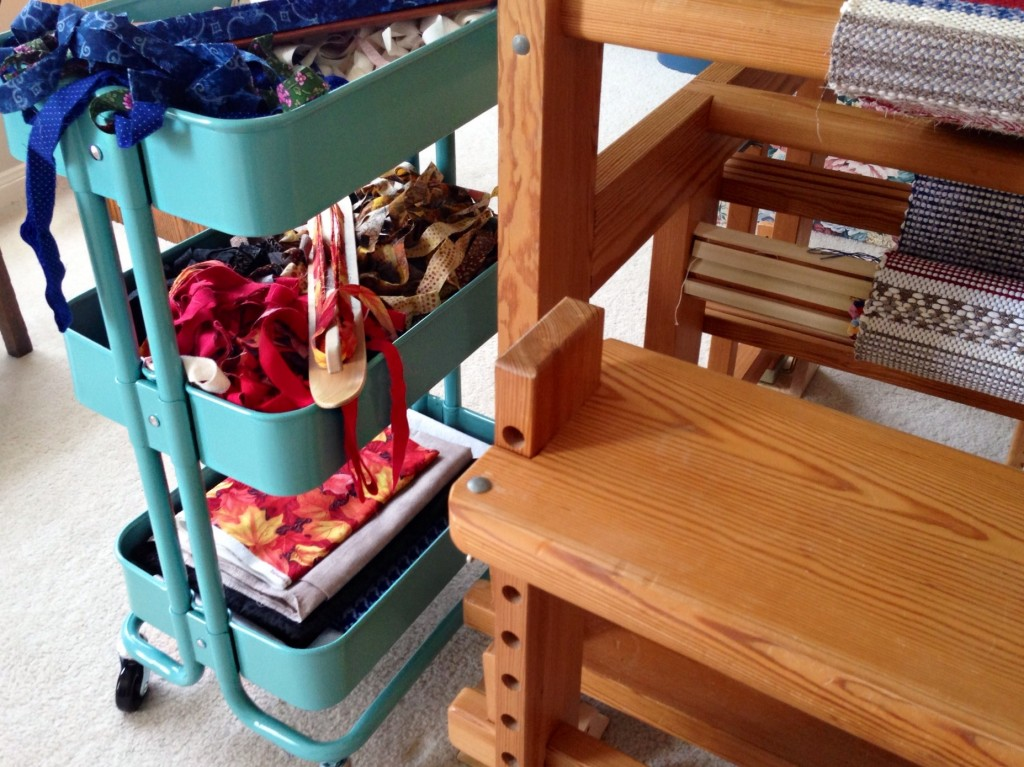 Ikea cart beside the loom while weaving rag rugs.
