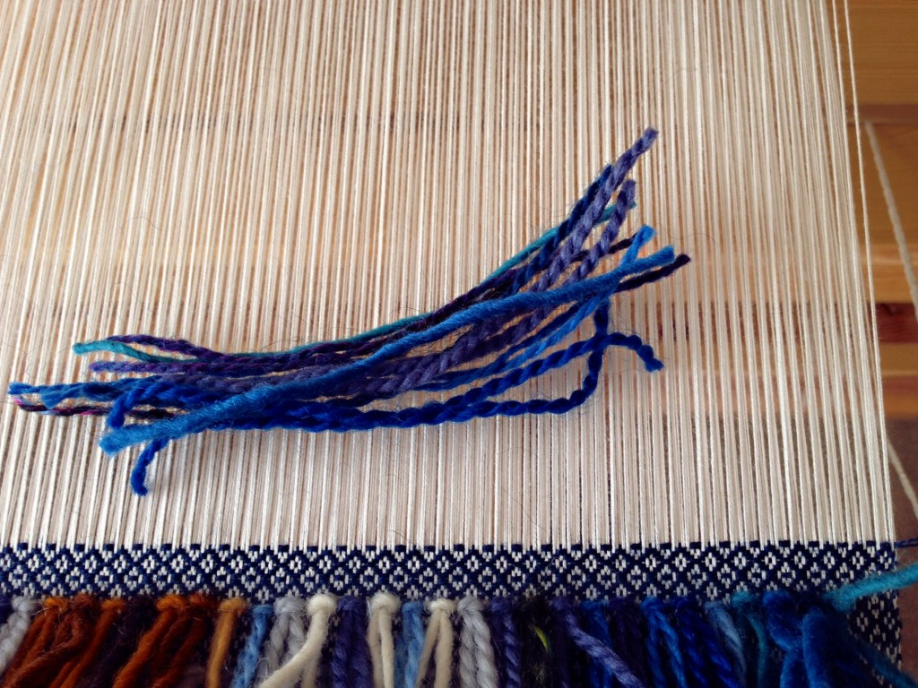 Mixing blue wool strands for rya knots. Pics with rya knots.