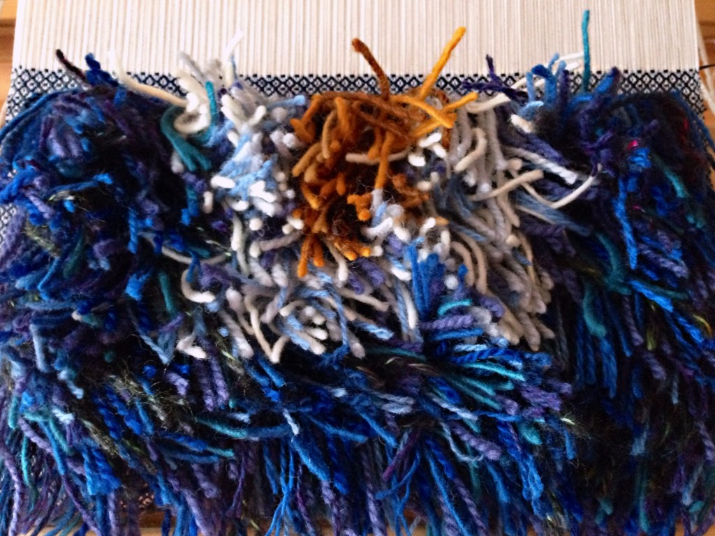 47 rya knots across each row, forming a shaggy pillow top. Karen Isenhower