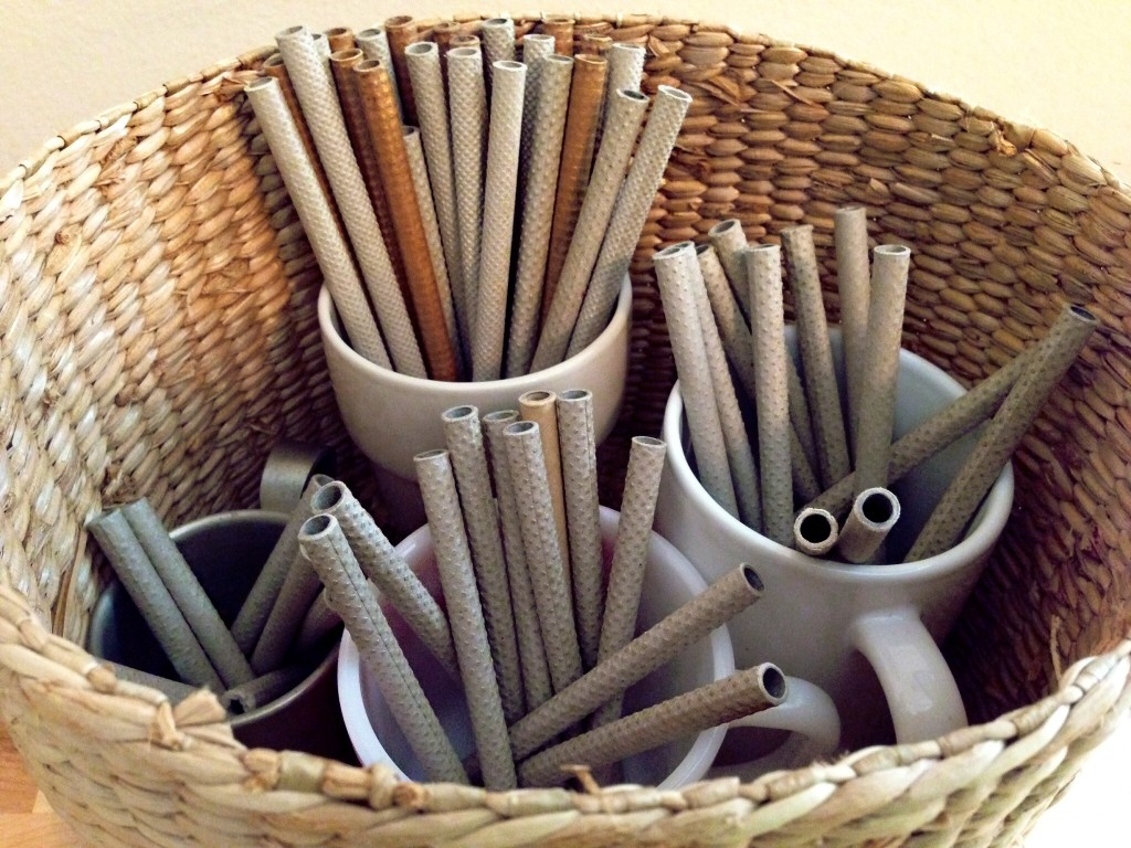 Basket with mugs keep quills organized.