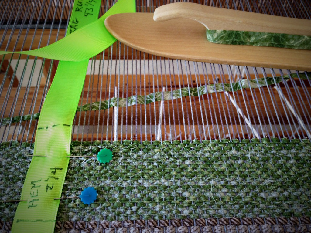 Weaving narrow strips for rag rug hem.