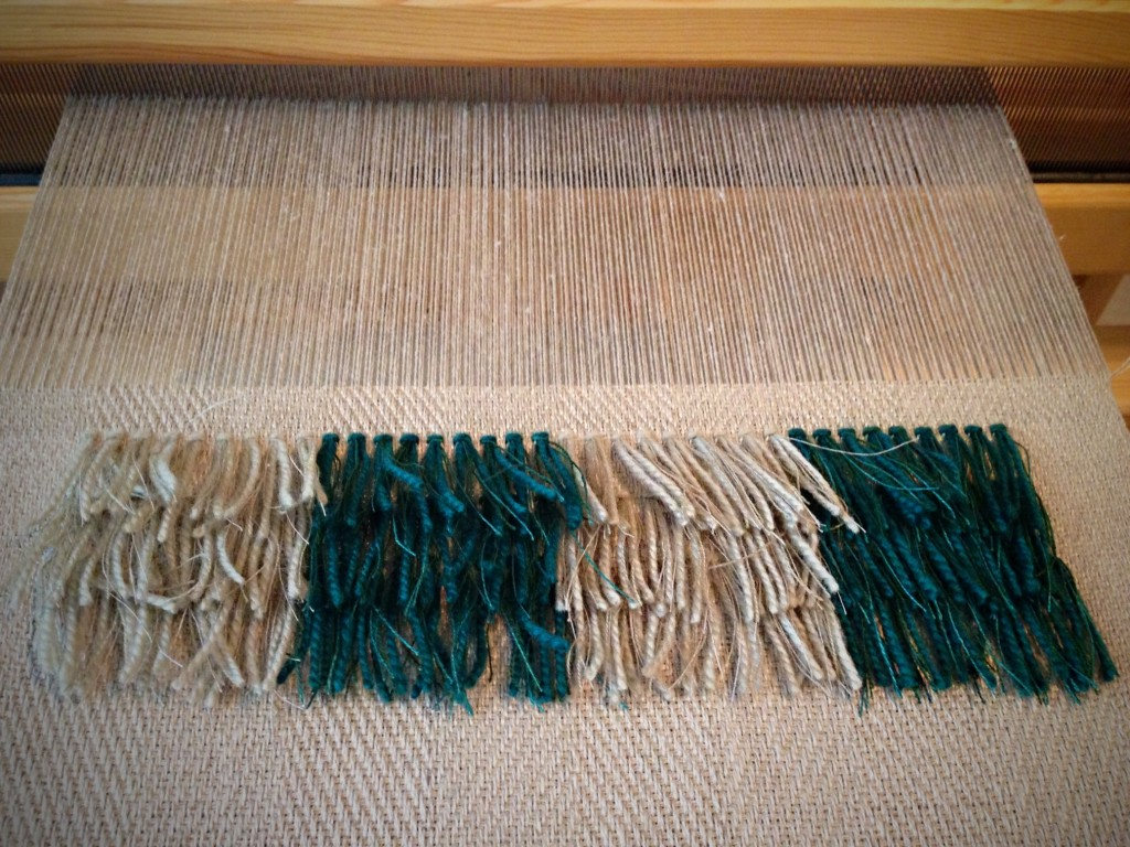 Rya knots in linen cloth.