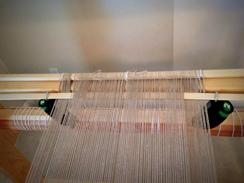 Evening out warp tension with weights