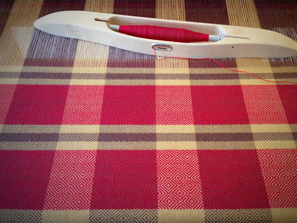 Red and brown goose-eye towel on the loom.