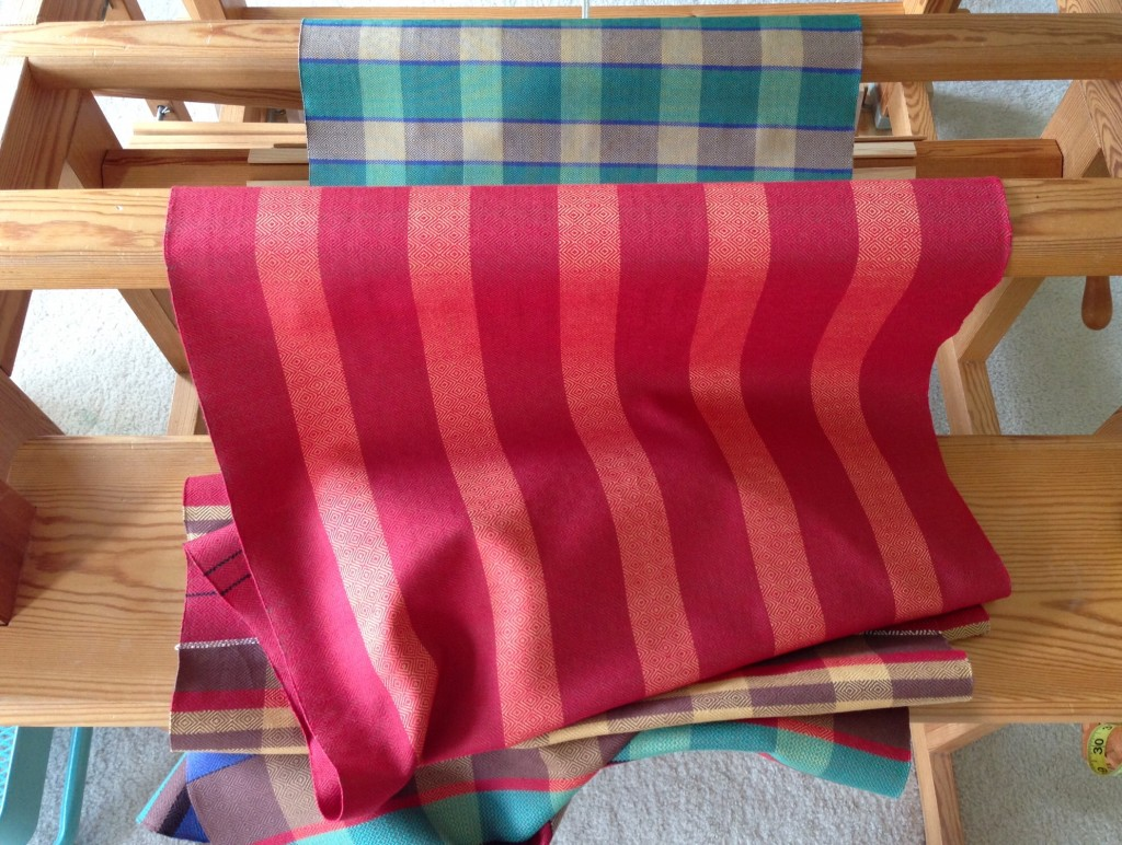 Red striped towel coming off the loom.