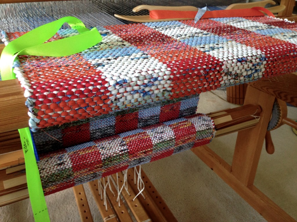 Rag rugs on the loom.