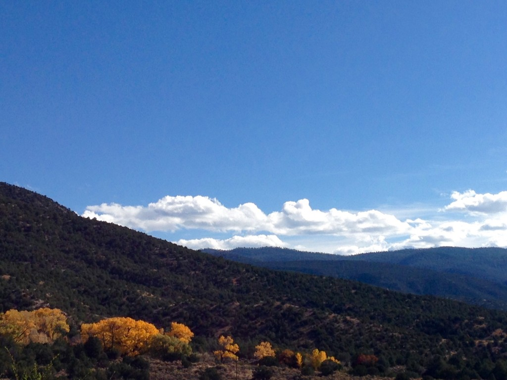 Majestic mountains and colorful cottonwood trees in New Mexico.