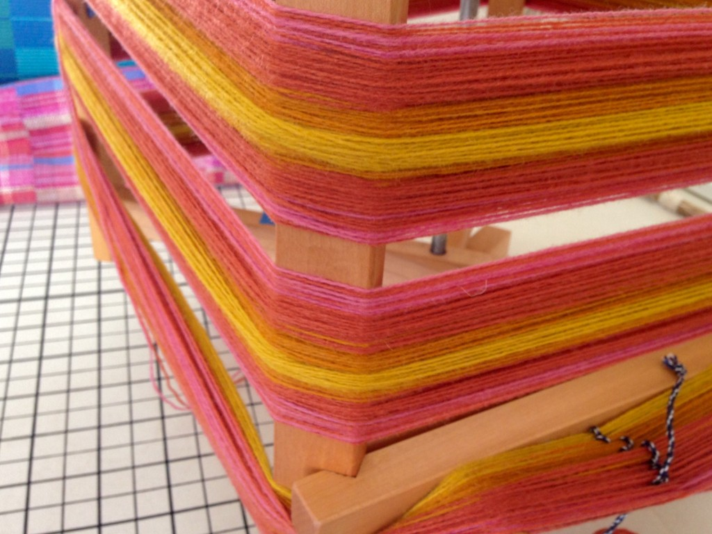 Winding wool warp on warping reel.