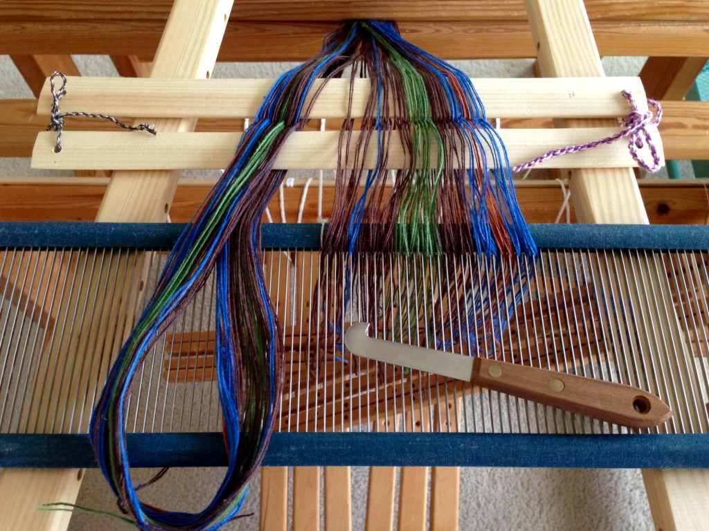 Spreading the warp, pre-sleying the reed.