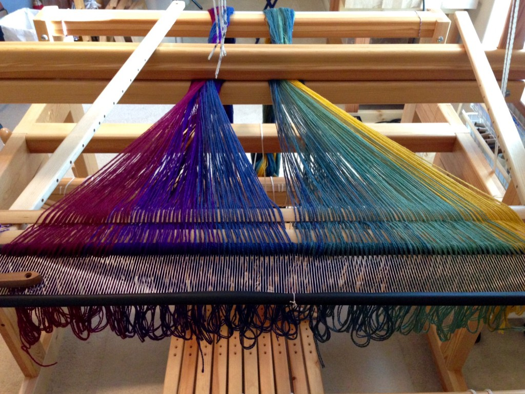 Bottom layer of double weave blanket is spread on the loom.