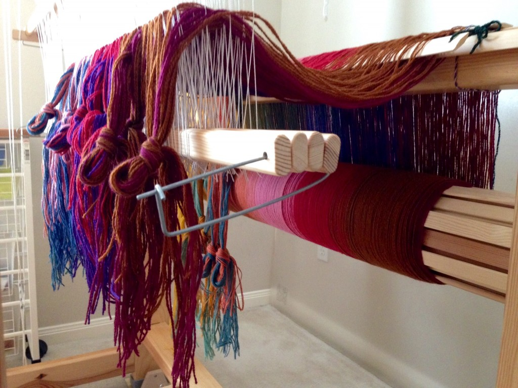 Threading heddles for multi-color wool blanket.