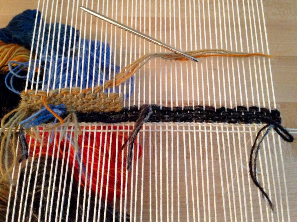 Weaving small tapestry from the back.