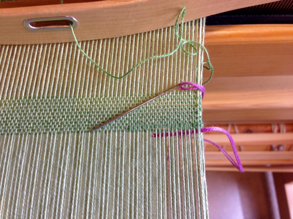 Thread secured at beginning of hemstitching. Hemstitching how-to.