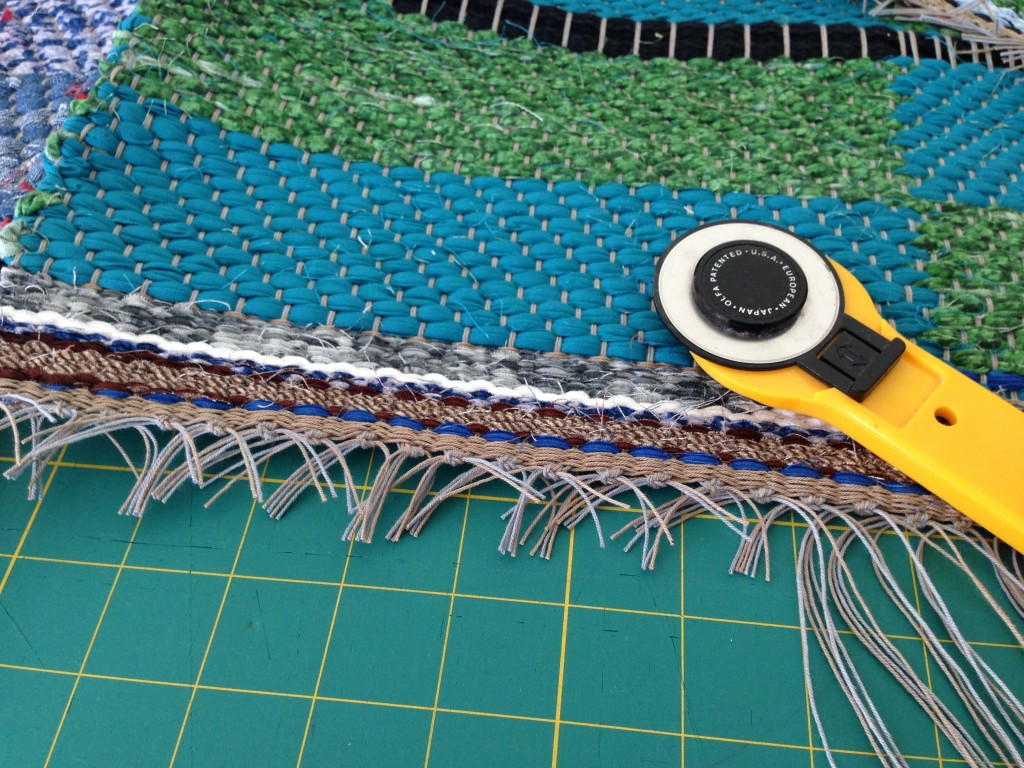 Securing warp ends of rag rug.
