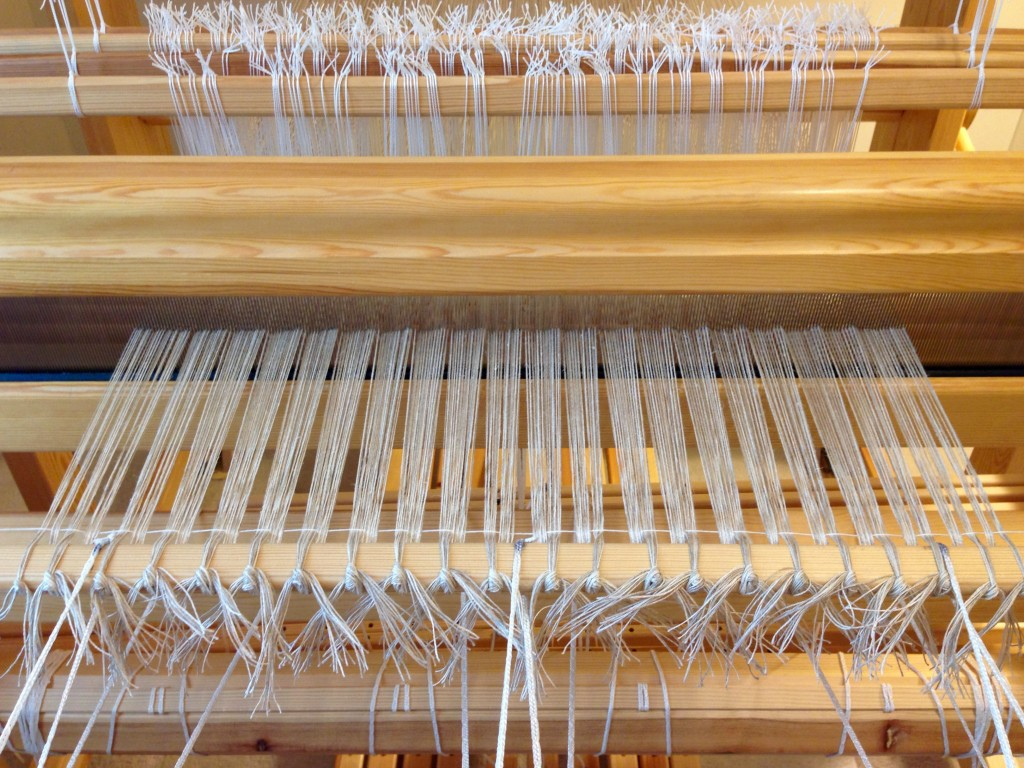Getting ready to weave with linen. Tying on.