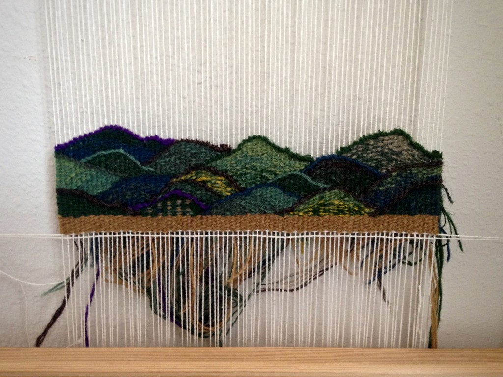 Small tapestry diary progress, woven from the back.