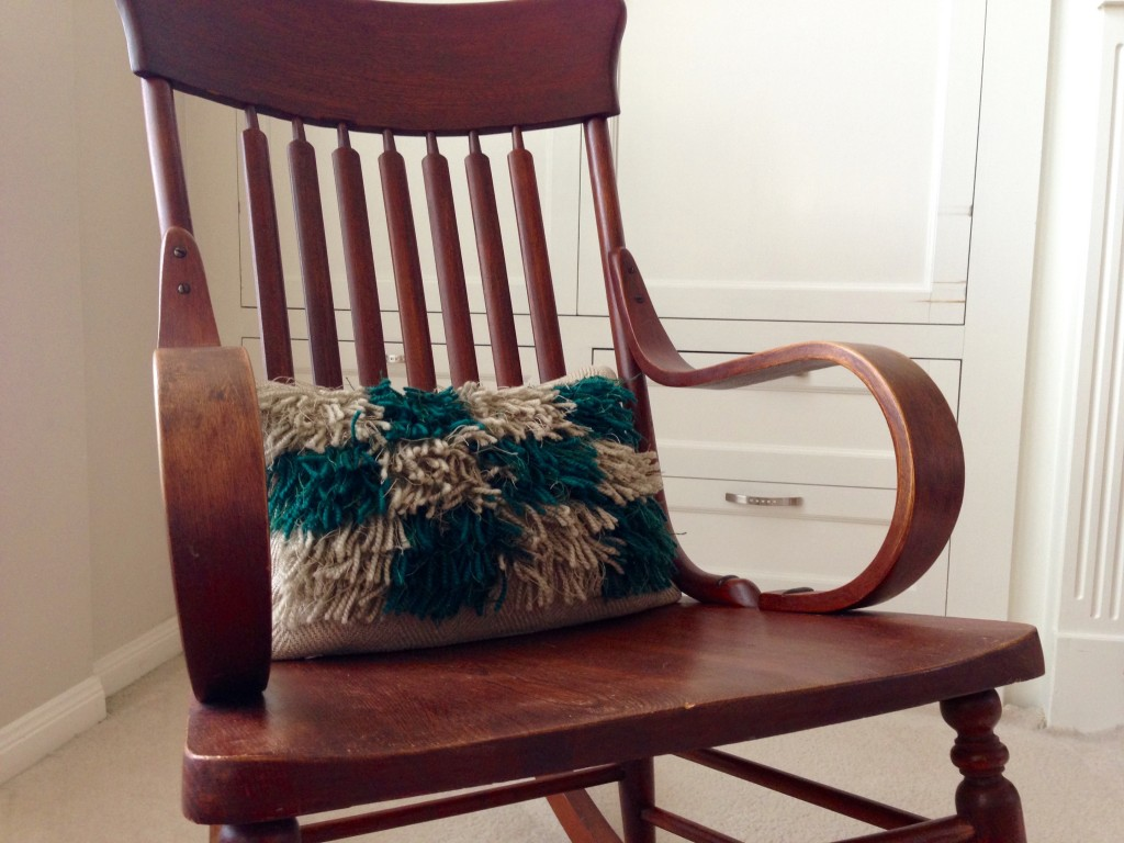 Great grandmother's rocking chair with new handwoven rya pillow.