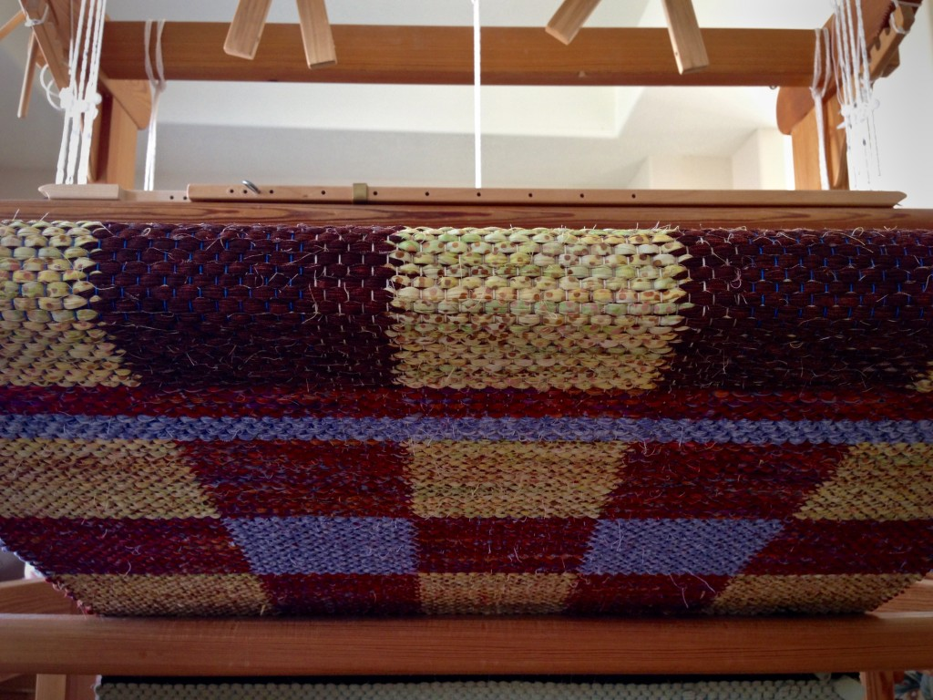 Patterned rag rug on the loom.