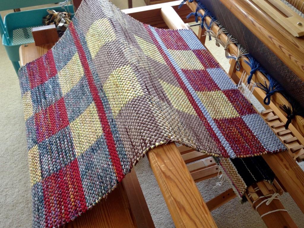 Rag rug unrolled from the loom. Karen Isenhower