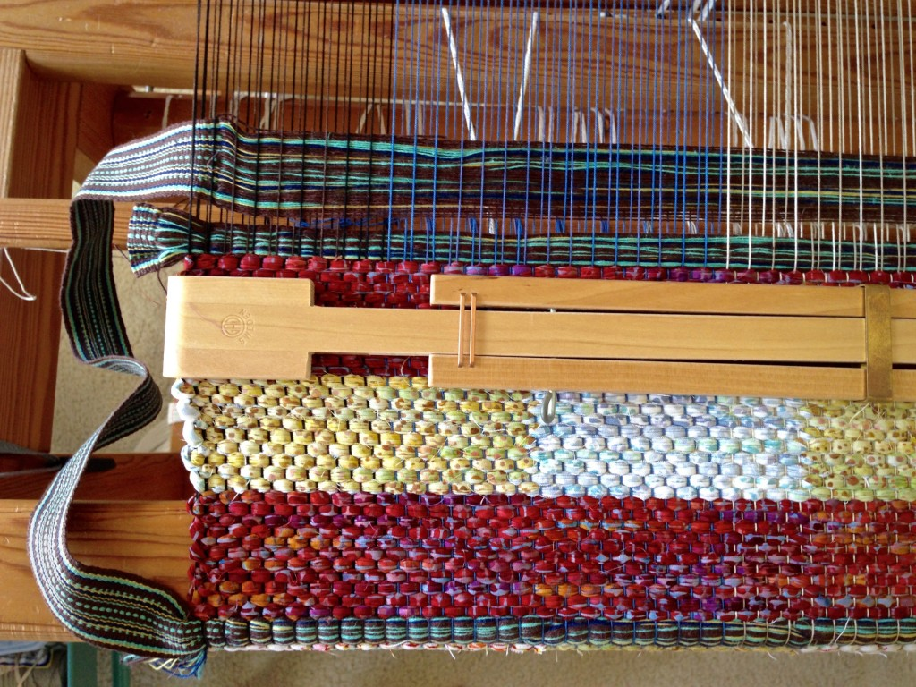 How to insert bag handles into the weaving.