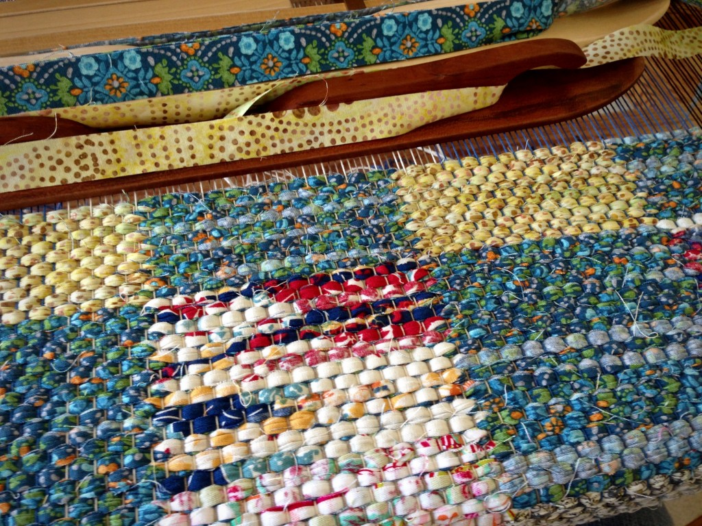 Two ski shuttles for weaving double binding rag rugs.
