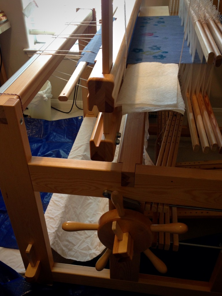 Painting and stamping warp on the loom.