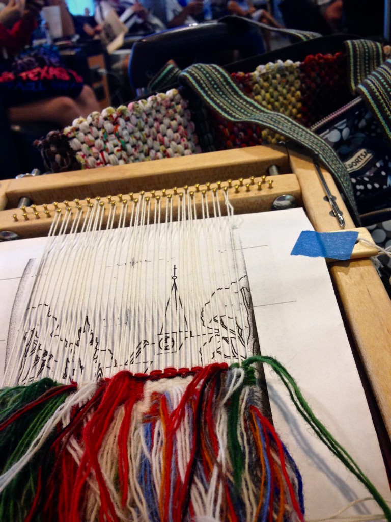 Weaving small tapestry while traveling.