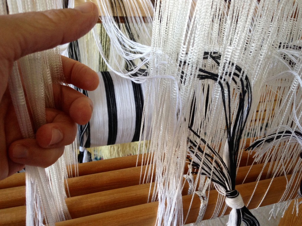 Threading Texsolv heddles.