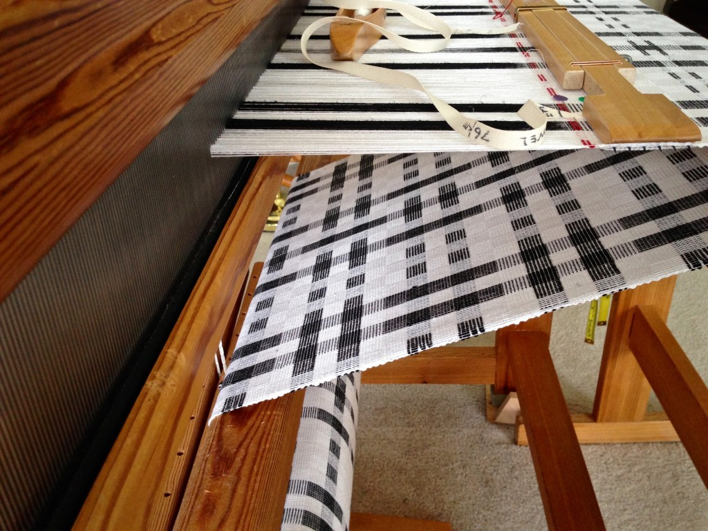 Temple in place for weaving black and white cottolin towels.