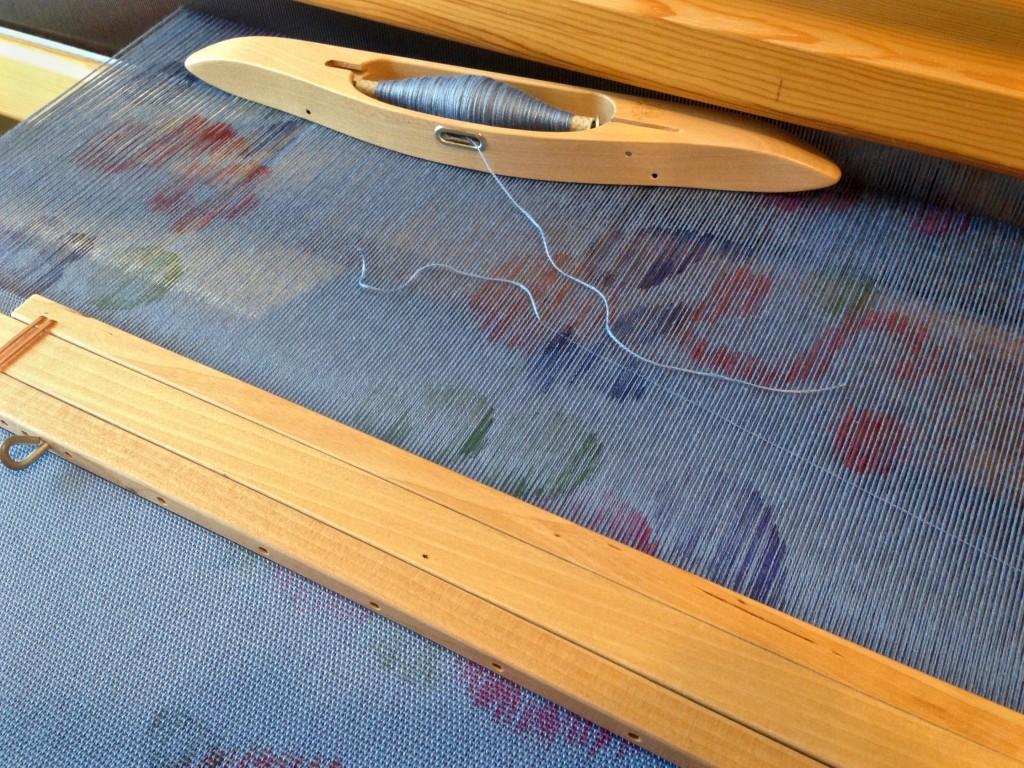Stamped warp on the loom.