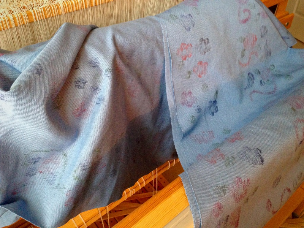 Warp was stamped on the loom, using fabric paint, before it was woven.