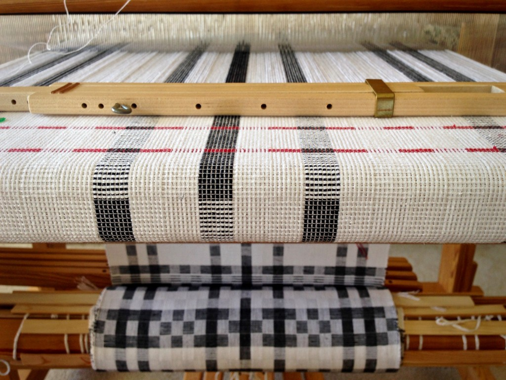 Thick and thin cottolin hand towels on the loom with interesting patterns.