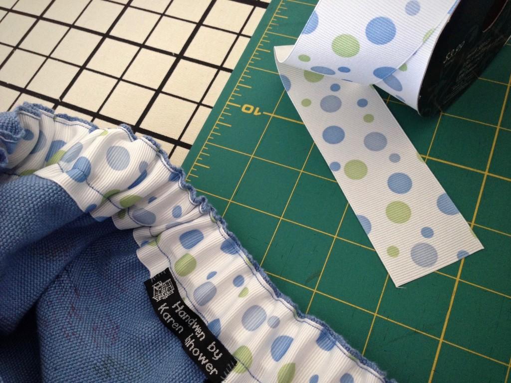 Grosgrain ribbon for elastic casing in handwoven skirt waistband, reducing bulk.
