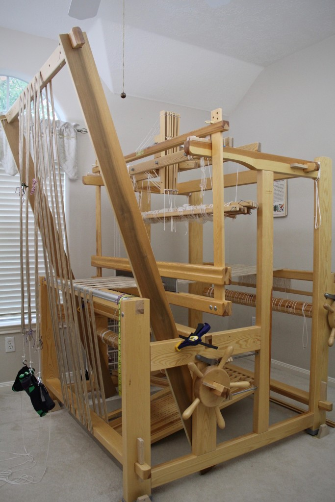 Warping trapeze in action to beam linen warp.