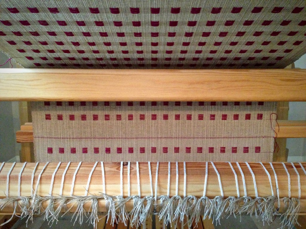 Linen dice weave coming around the cloth beam. Karen Isenhower