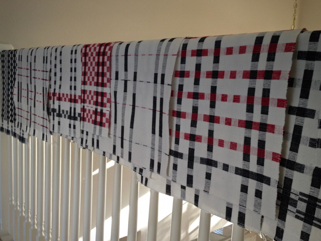 Black and white and a little red. Handwoven towels.