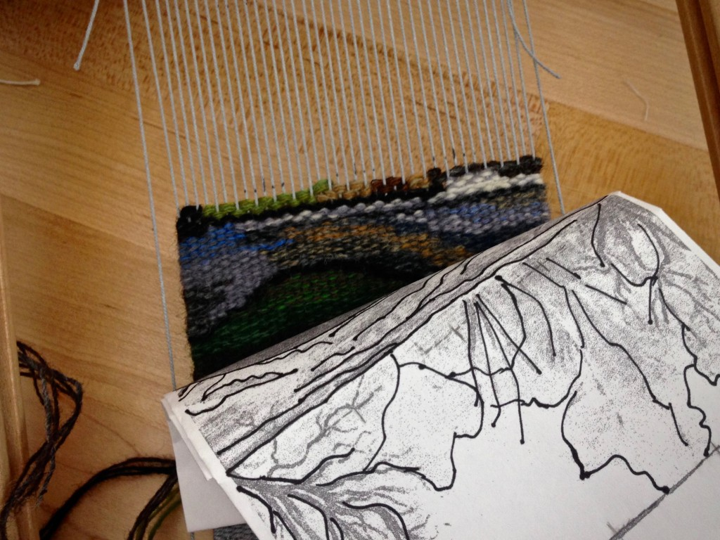 Weaving small tapestry on travel loom.