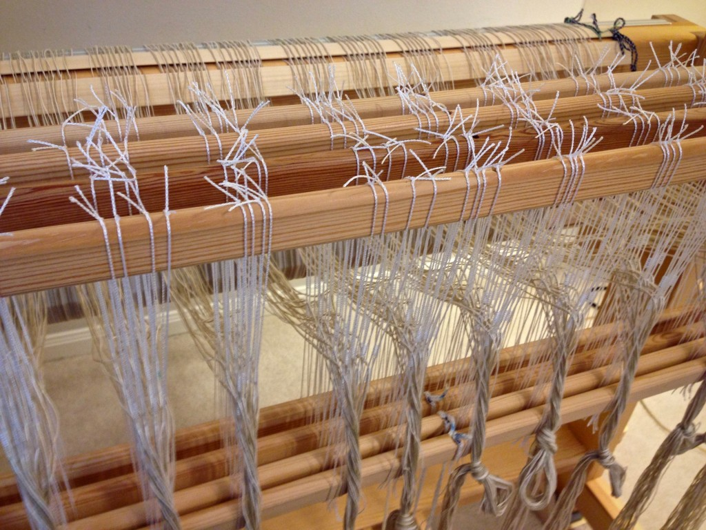 Threading the loom for rag rugs.