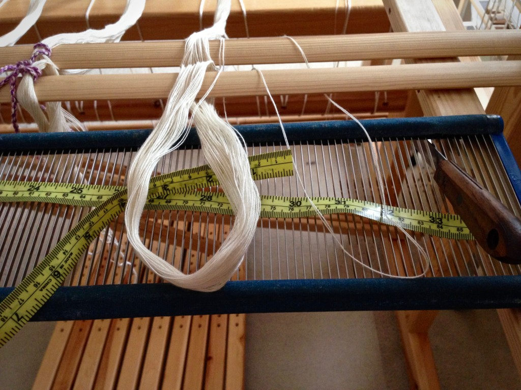 Pre-sleying the reed in back to front warping.