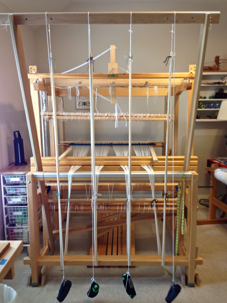 Adjusting the warp on the warping trapeze.