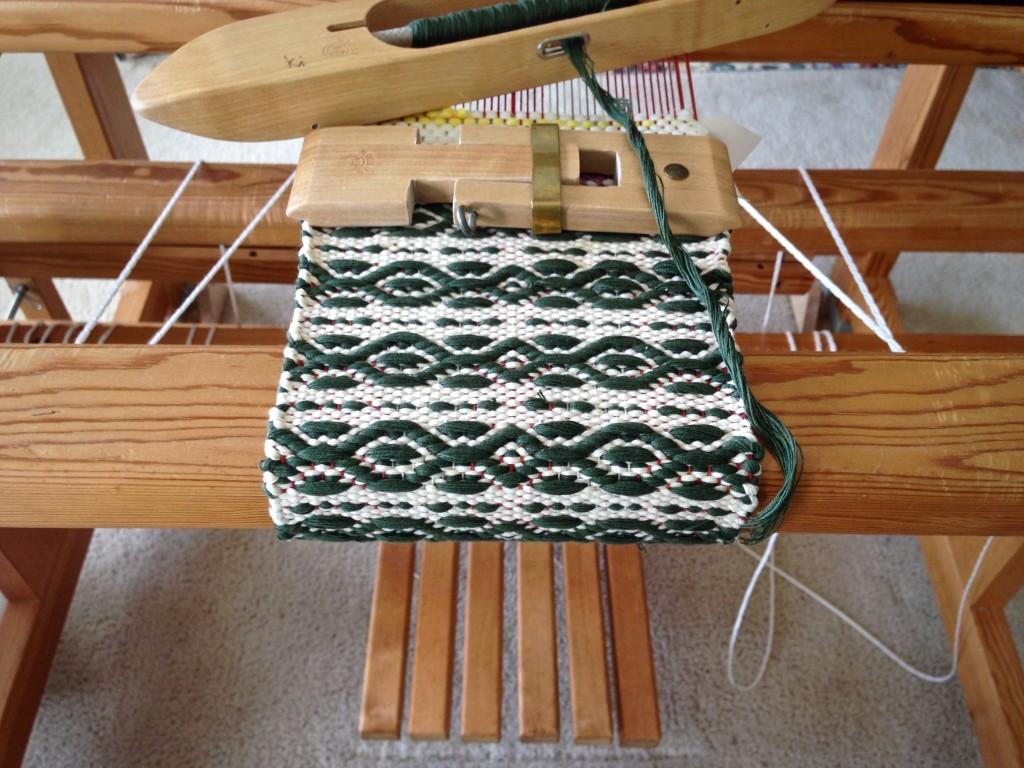 Mug rug being woven with string yarn. Customized mini temple.