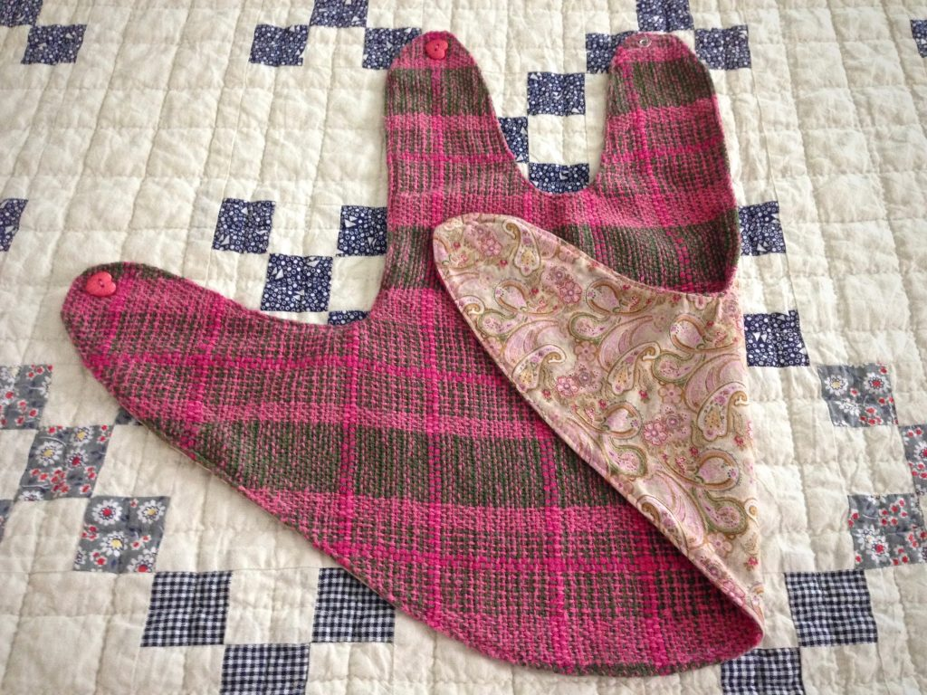 Baby girl pinafore made from handwoven fabric. Rigid heddle loom.