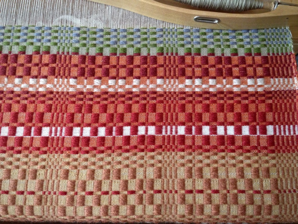 Monksbelt with 9 colors of Faro wool pattern weft. Karen Isenhower